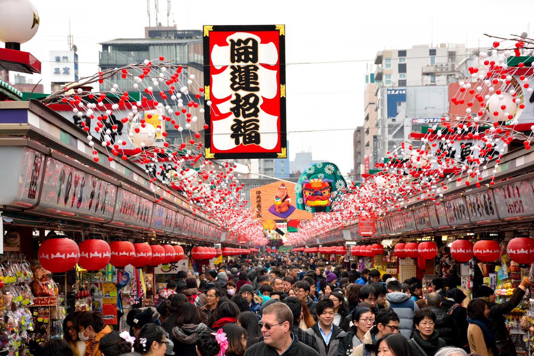 The famous Nakamise Shopping Street is crowded with tourists and visitors outside Asakusa Temple in Tokyo, Japan