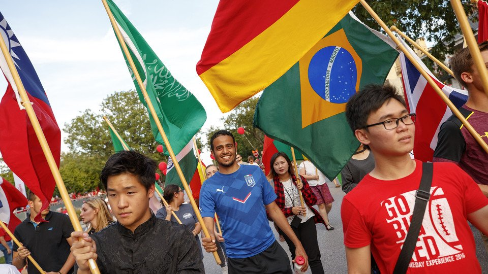 International students show their home country pride at the Homecoming Parade
