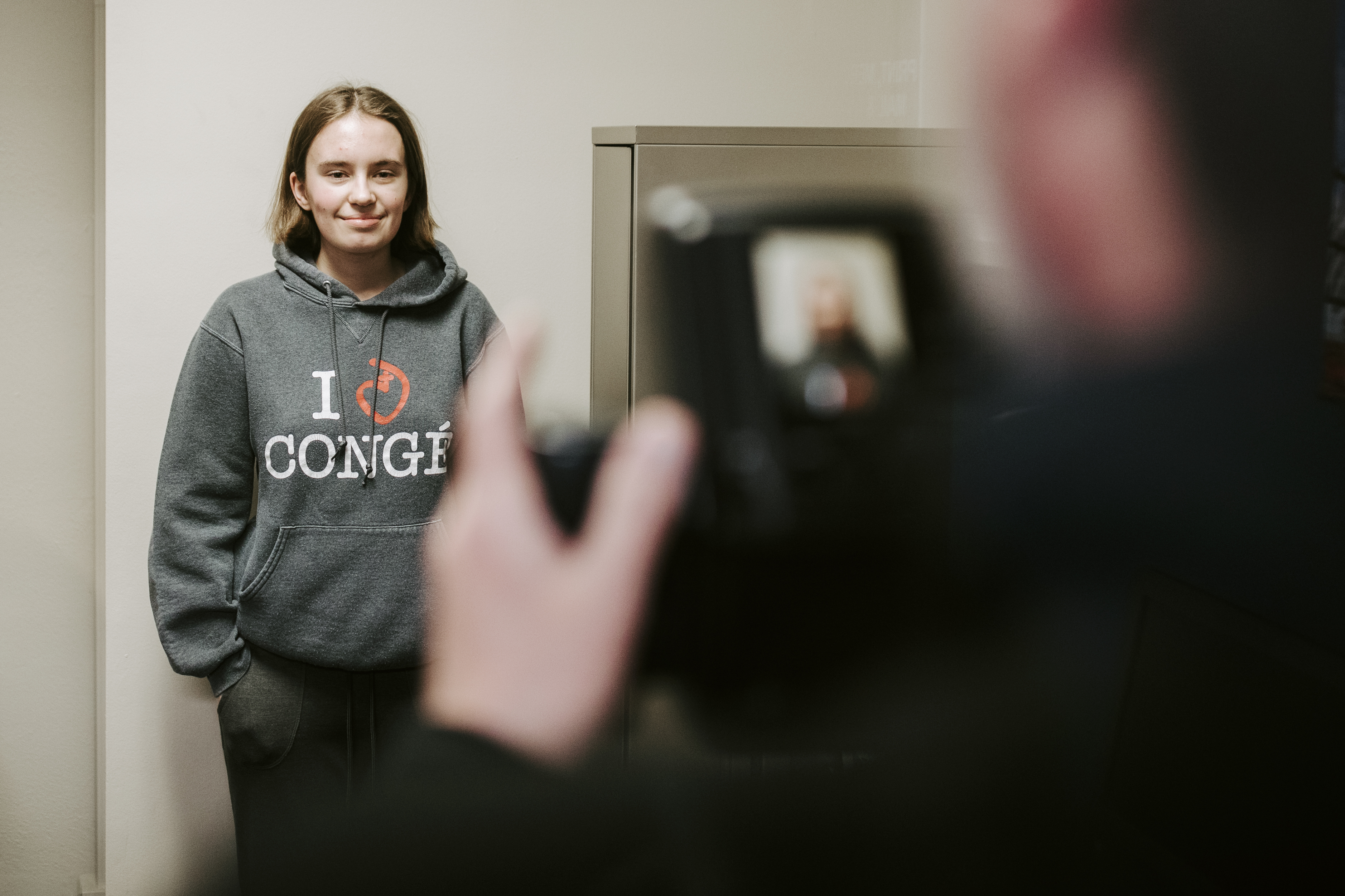 Freshman Grace Gawecki poses for her application photo at the UNL Passport Office. Gawecki was one of 88 UNL students who applied for a passport through the Husker Passport Giveaway.