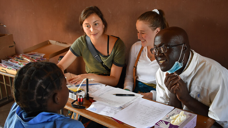 "Two University of Nebraska–Lincoln students sit in on a local meeting during their ""Food Security, Health and Nutrition"" program in Zambia and Ethiopia in summer 2019. Led by Mary Willis, the study abroad program has included 15 Husker Gilman Scholars since its inception in 2014."