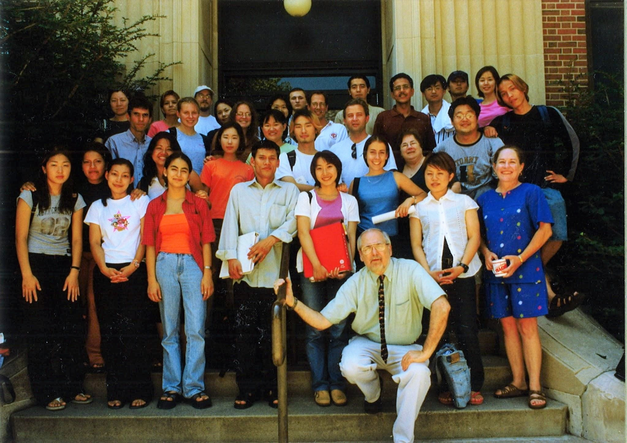 PIESL lecturers and staff pose with some of the summer program students in 2001.
