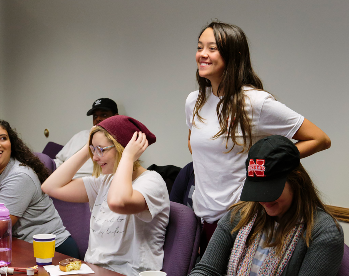 "Elizabeth Byrnes (standing), a junior sociology and communication studies double major, describes her experience with the UNL Global Virtual Project as ""nothing less than eye-opening."