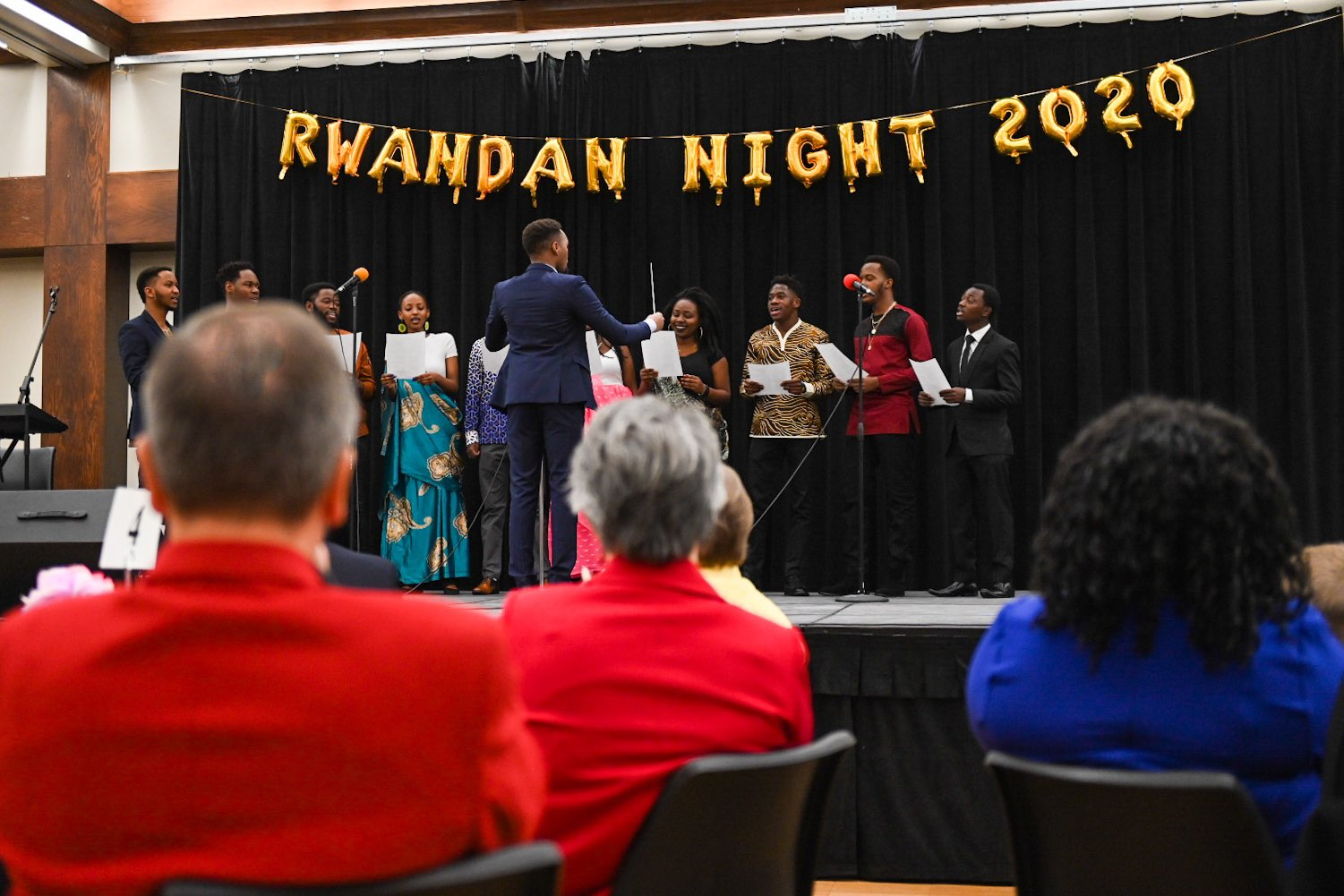 Chancellor Ronnie Green and the Ambassador of Rwanda Mathilde Mukantabana pose with Rwandan students at the end of the first Rwanda Night celebration.
