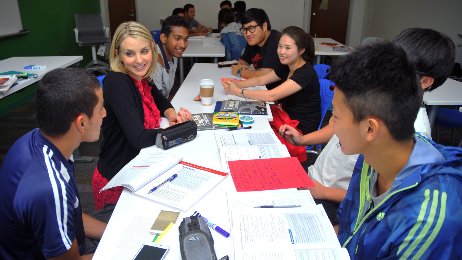 Students meet with a PIESL staff member to improve their English skills. Courtesy photo.