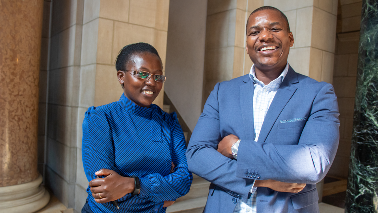 Two fellows from the 2019 Nebraska Institute of the Mandela Washington Fellowship for Young African Leaders stand in the Nebraska State Capitol.