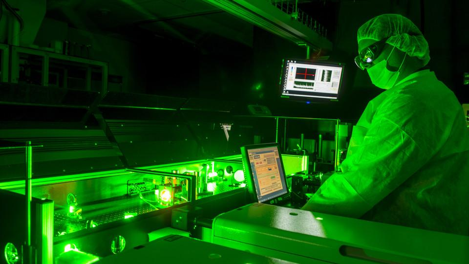 A technician aligns a laser at the Extreme Light Laboratory. The university is one of nine founding members of the LaserNetUS network.